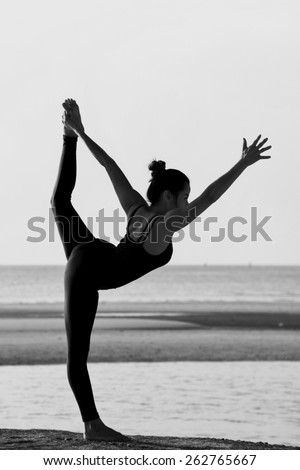 High quality, high resolution, professional yoga woman silhouette at sunset.
