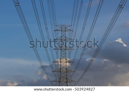 High voltage electricity tower in the sky in the evening