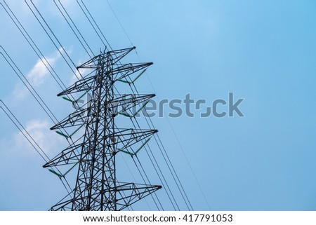 High voltage tower with blue sky.