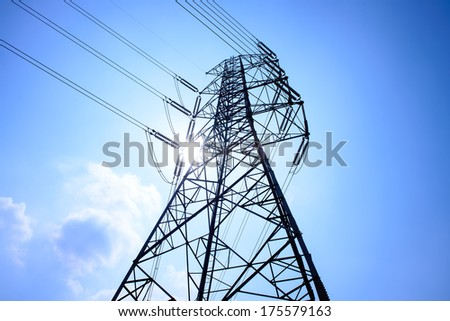 High voltage towers with sky background. blue toned images.