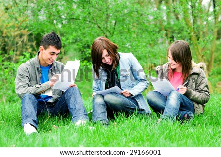 Highschool students learning together outdoor