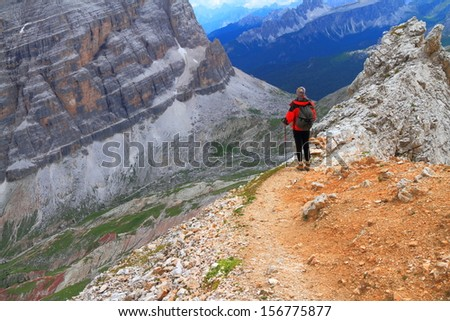 Hiker on the mountain trail, Dolomite Alps, Italy