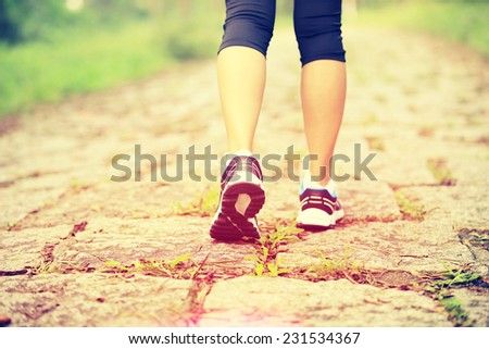hiking woman legs walking on forest trail