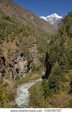Himalayan Dhudh Khosi River Gorge with distant Cholatse Peak