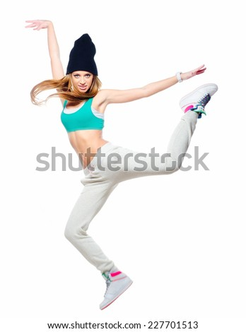 Hip hop dancer jumping high in the air isolated on white background.