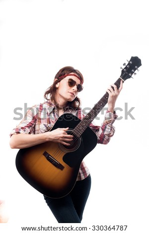 Hippie girl in heart shaped glasses playing guitar.  Isolated on white background.