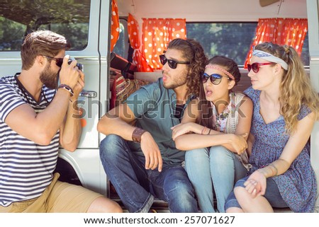 Hipster friends taking a photo on a summers day