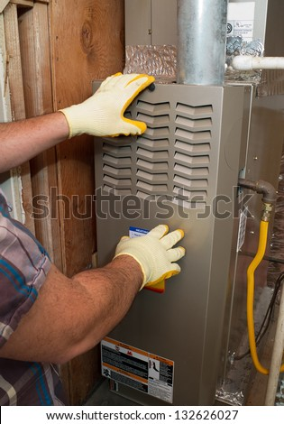 Hispanic airconditioning repair man performing maintenance