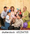 Hispanic family at birthday party - stock photo