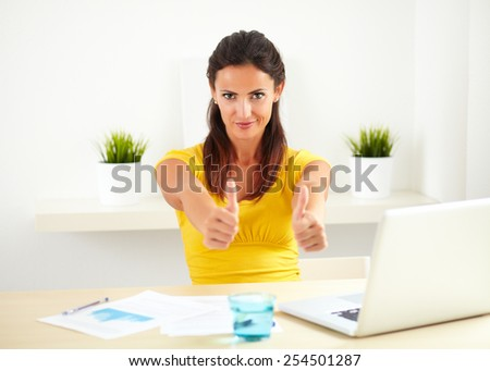 Hispanic female working as a boss in a business company while showing you her pleased satisfaction - copyspace