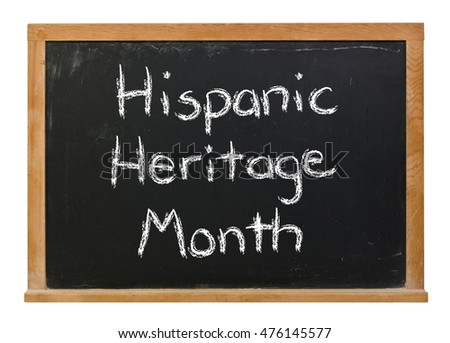 Hispanic Heritage Month written in white chalk on a black chalkboard isolated on white