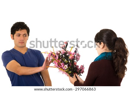 Hispanic man saying no to flowers from woman.