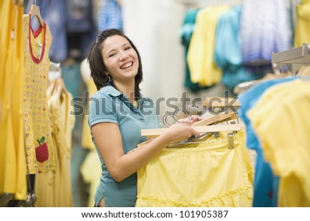 pretty-latin-girl-shopping-clothes-cute-young-hispanic-woman-buying-some-store-smiling-34345620.jpg