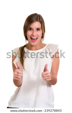Hispanic young woman with success expression. Thumbs up. Image isolated on white with clipping path.