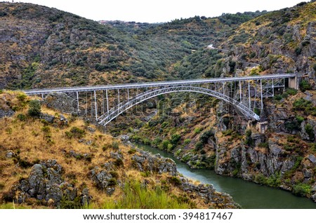 Historic iron bridge over the Douro river