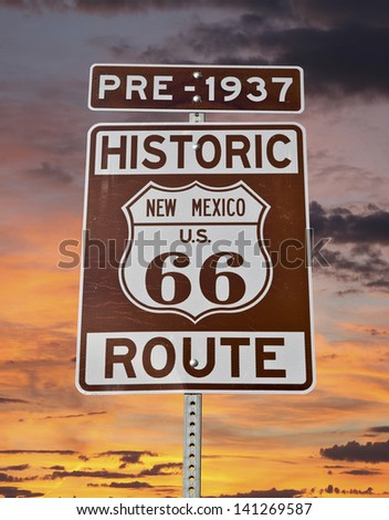Historic Route 66 New Mexico Sign with sunrise sky.