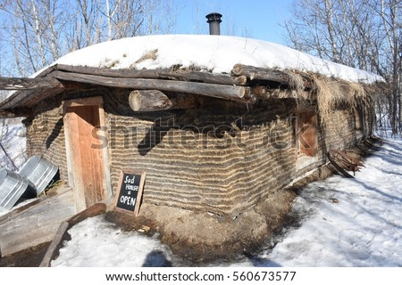 historic sod house in winter where pioneer lived located at the Fort Whyte Centre in Winnipeg Manitoba