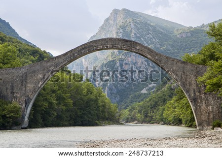 Historical stone bridge of Plaka at Epiros, above Arahtos river