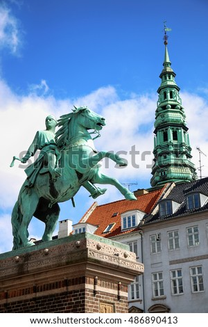 Hojbro Plads Square with the equestrian statue of Bishop Absalon and St Kunsthallen Nikolaj church in Copenhagen, Denmark