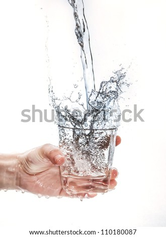 Holding cups, splashing water