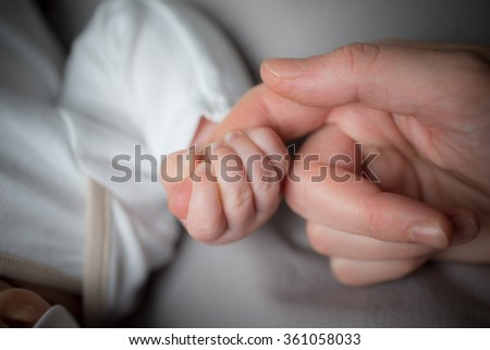 Holding Hands,  Cute sweet little baby keeps mom's fingers