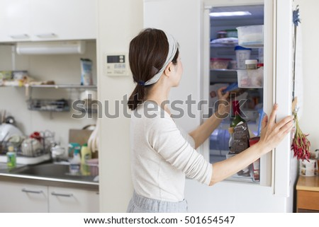 Holiday morning, women take out the food from the refrigerator