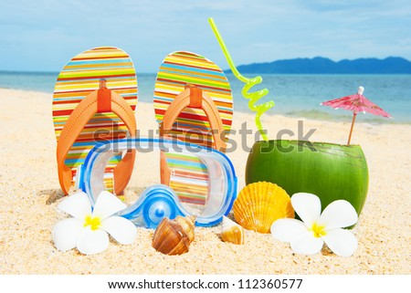 Holidays background. Beautifuk beach with palms and coctail