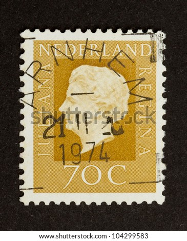 HOLLAND - CIRCA 1970: Stamp printed in the Netherlands shows the queen (Juliana), circa 1970