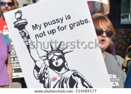HOLLYWOOD, CA - NOVEMBER 13 2016: A female protester holds a sign which reads, My Pussy Is Not Up For Grabs during an anti Trump rally on November 13, 2016 in Hollywood, California.