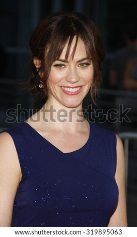 "HOLLYWOOD, CALIFORNIA - August 30, 2011. Maggie Siff at the Season 4 premiere of FX Network's ""Sons Of Anarchy"" held at the ArcLight Cinemas, Los Angeles."