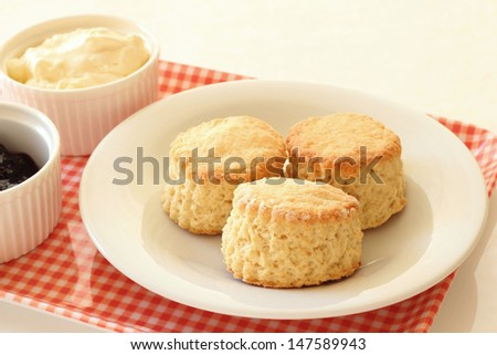 Home-baked scones with clotted cream, jam and tea
