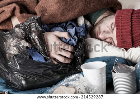Homeless young man sleeping on the street