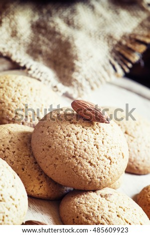 Homemade almond cookies, vintage wooden background, toned image, selective focus
