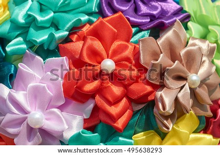 Homemade artificial colored flowers close up