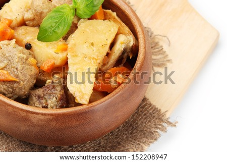 Homemade beef stir fry with vegetables in color bowl, on wooden board, isolated on white