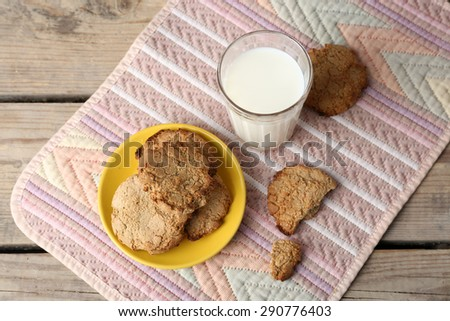 Homemade cookies and glass of milk on table close up