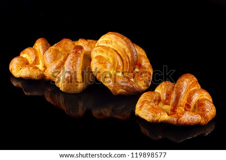 homemade croissants, isolated on black