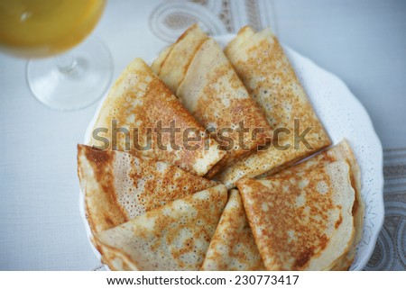 Homemade fishnet pancakes on the table