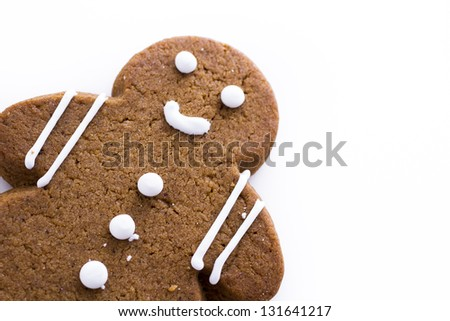 Homemade gingerbread cookies decorated with white icing on white background.