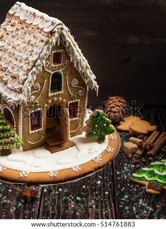 Homemade gingerbread house on dark background, xmas theme
