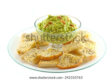 Homemade guacamole with fresh made crostini's served platter style.