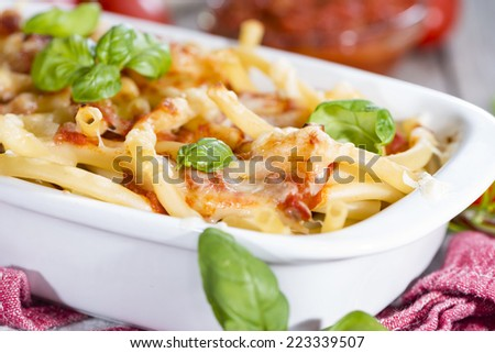 Homemade Pasta Bake (with Macaroni) on wooden background
