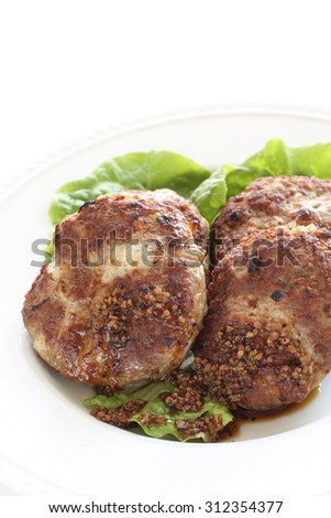 Homemade patty on lettuce for gourmet food image