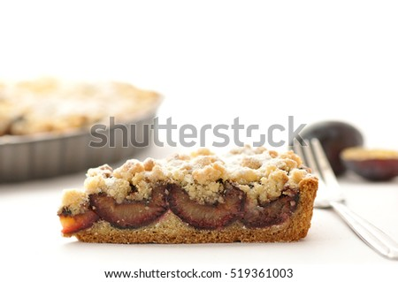 Homemade pie with plums on white background