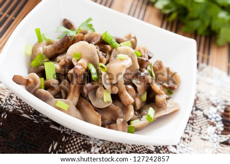 ... mushrooms and basil on a plate food pasta with mushrooms in a bowl