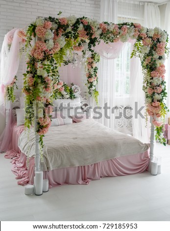 Honeymoon suite with canopy bed free space. Luxurious wood canopy bed with flowers and & Honeymoon Suite Canopy Bed Free Space Stock Photo 729185884 ...