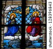 HONFLEUR - FEBRUARY 11: Jesus and Mother Mary in Paradise on a stained glass window in Saint Catherines church in Honfleur, Calvados, France on February 11, 2013. - stock photo