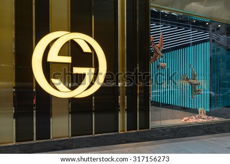 HONG KONG - AUG 15, 2015: Gucci store at night. Gucci is an Italian fashion and leather goods brand was founded by Guccio Gucci in Florence in 1921. Gucci has about 425 stores worldwide.