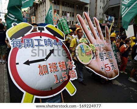 HONG KONG, CHINA - JULY 1: Unidentified Hong Kong citizens participate in the annual July 1 march to demand minimum wage labour protection from the government on July 1, 2012 in Hong Kong, China.