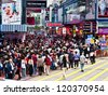 HONG KONG -NOV 24: Shoppers and visitors crowd at a shopping street on Nov 24, 2012 in Hong Kong, China. There are more than 35 million of visitors arrived Hong Kong from January to September 2012. - stock photo